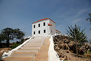 The white painted chapel of the Slave museum stands opposite the island of Mussulo. Luanda, Angola. Africa. .Pictures © Z & D Lightfoot..www.lightfootphoto.co.uk