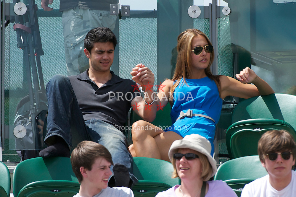 LONDON, ENGLAND - Friday, July 1, 2011: A couple mess about together during the Boys' Singles Semi-Final match on day eleven of the Wimbledon Lawn Tennis Championships at the All England Lawn Tennis and Croquet Club. (Pic by David Rawcliffe/Propaganda)