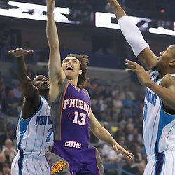 Feb 01, 2010; New Orleans, LA, USA; Phoenix Suns guard Steve Nash (13) shoots between New Orleans Hornets guard Darren Collison (2) and forward David West (30) during the first half at the New Orleans Arena. The Suns defeated the Hornets 109-100.  Mandatory Credit: Derick E. Hingle-US PRESSWIRE