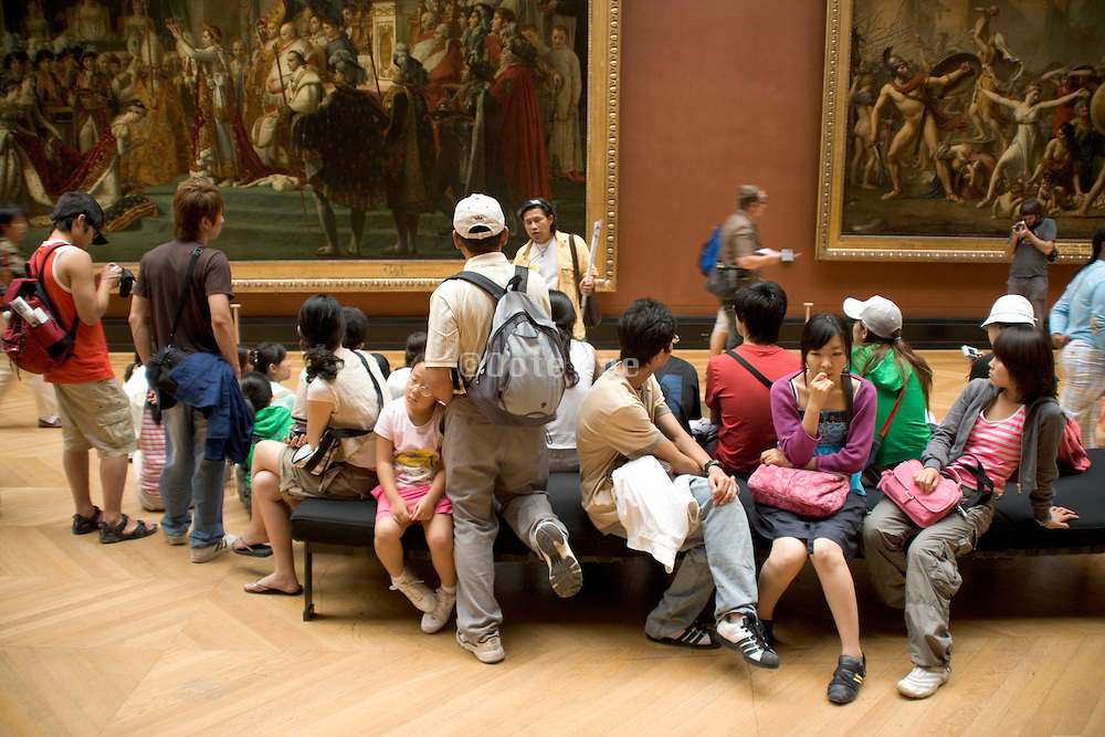 Asian teenagers on a art history trip Musee du Louvre Paris