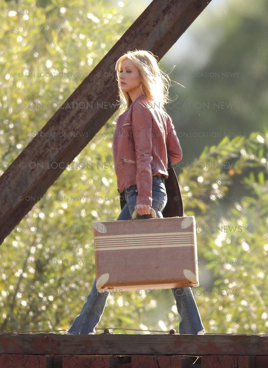 TUESDAY NOVEMBER 17th, 2009.  PIRU, CALIFORNIA. NON EXCLUSIVE. Christina Aguilera crossing a train track bridge while filming scenes for her movie Burlesque. This is the part of the movie where Christina's character leaves her small town and heads towards Los Angeles to see what she is made of. Photo by Eric Ford/On Location News 818-613-3955 info@onlocationnews.com