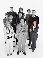Portrait of confident business team standing with arms crossed against white background
