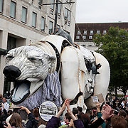 Aurora outside Shell's London HQ. The giant polar bear puppet Aurora made by Greenpeace walked the streets of London in defence of the Arctic as part of a Greenpeace global day of action. The parade,part performance part protest, was to highlight the melting ice caps and the increasing and potentially devastating oil drilling in the arctic sea. Shell is one of the companies drilling and the march through London ended up outside Shell London HQ to draw attention to their oil business in the arctic. Aurora, the biggest polar bear in the world represents all endangered species in arctic.