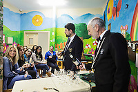 LECCE, ITALY - 10 NOVEMBER 2016: (R-L) Roberto Giannone and Marco Albanese, two trained sommeliers, volunteer to lecture female inmates on the arts and crafts of wine tasting and serving, in the largest penitentiary in the southern Italian region of Apulia, holding 1,004 inmates in the outskirts of Lecce, Italy, on November 10th 2016.<br /> <br /> Here a group of ten high-security female inmates and aspiring sommeliers , some of which are married to mafia mobsters or have been convicted for criminal association (crimes carrying up to to decades of jail time), are taking a course of eight lessons to learn how to taste, choose and serve local wines.<br /> <br /> The classes are part of a wide-ranging educational program to teach inmates new professional skills, as well as help them develop a bond with the region they live in.<br /> <br /> Since the 1970s, Italian norms have been providing for reeducation and a personalized approach to detention. However, the lack of funds to rehabilitate inmates, alongside the chronic overcrowding of Italian prisons, have created a reality of thousands of incarcerated men and women with little to do all day long. Especially those with a serious criminal record, experts said, need dedicated therapy and professionals who can help them.