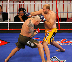 August 2, 2007; East Rutherford, NJ, USA; The Silverbacks Ben Rothwell (Yellow Trunks) knocks out the Anacondas Krzysztof Soszynski (Green Trunks) in the first round of their semifinal bout at the Continental Airlines Arena in East Rutherford, NJ.