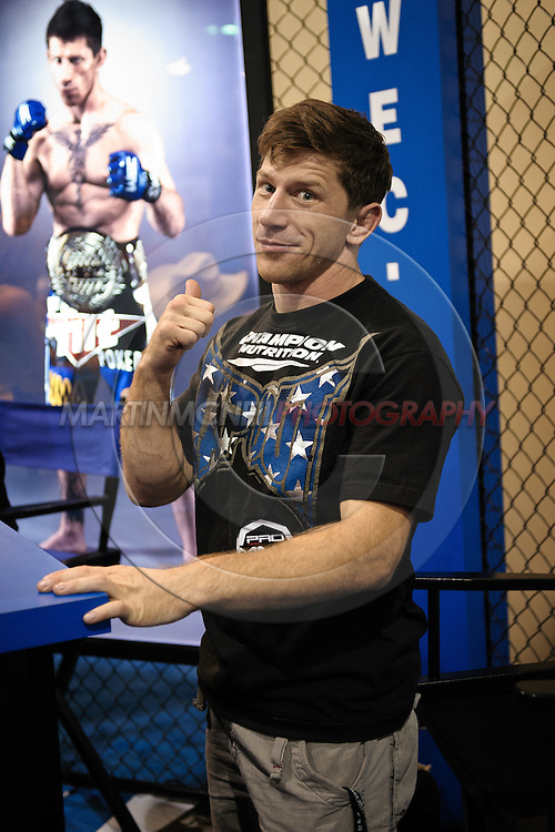 LAS VEGAS, NEVADA, JULY 10, 2009: Mike Brown points to a poster of himself during the UFC Fan Expo inside the Mandalay Bay Convention Centre in Las Vegas, Nevada