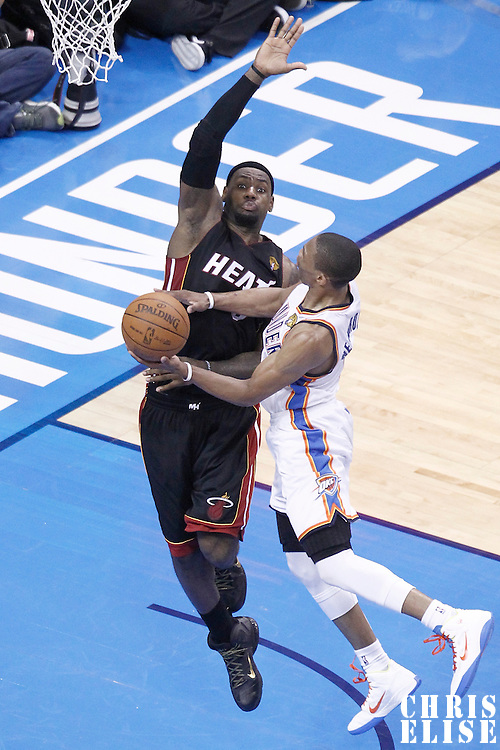 14 June 2012: Oklahoma City Thunder point guard Russell Westbrook (0) goes to the layup against Miami Heat small forward LeBron James (6) during the Miami Heat 100-96 victory over the Oklahoma City Thunder, in Game 2 of the 2012 NBA Finals, at the Chesapeake Energy Arena, Oklahoma City, Oklahoma, USA.