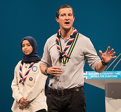 © Licensed to London News Pictures  . 03/10/2017 . Manchester , UK . Chief Scout BEAR GRYLLS speaks on stage ahead of the Home Secretary , during day three of the Conservative Party Conference at the Manchester Central Convention Centre . Photo credit : Joel Goodman/LNP