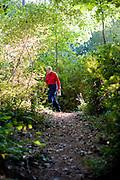 Allen DeHArt identifies native wildflowers as we hike the  trails at DeHart Botanical Gardens in Louisburg, NC.