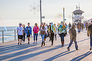 People Walking on the Huntington Beach Pier in the Afternoon in December