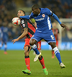 Caption correction * Cardiff City's Bruno Ecuele Manga battles for the ball with Bournemouth's Callum Wilson - Photo mandatory by-line: Alex James/JMP - Mobile: 07966 386802 - 17/03/2015 - SPORT - Football - Cardiff - Cardiff City Stadium - Cardiff City v AFC Bournemouth - Sky Bet Championship