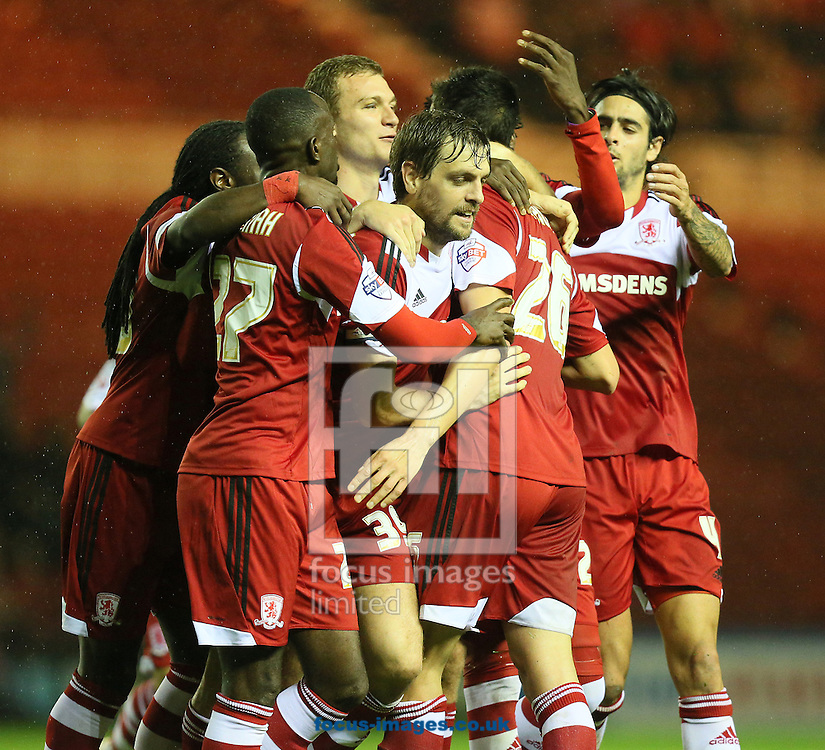 Picture by Paul Gaythorpe/Focus Images Ltd +447771 871632<br /> 25/10/2013<br /> Middlesbrough players celebrate Daniel Ayala scoring the fourth goal against Doncaster Rovers during the Sky Bet Championship match at the Riverside Stadium, Middlesbrough.