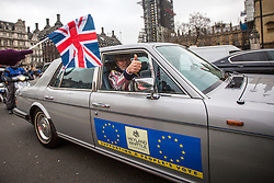 © Licensed to London News Pictures. 15/01/2019. London UK. A man drives his Rolls Royce around London in support of a people's vote as people protest in Parliament Square this afternoon ahead of todays vote on the Theresa May's Brexit deal. Photo credit: Andrew McCaren/LNP