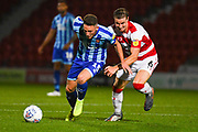 Blackpool midfielder Jordan Thompson (15) and Doncaster Rovers midfielder Ben Sheaf (6) during the EFL Sky Bet League 1 match between Doncaster Rovers and Blackpool at the Keepmoat Stadium, Doncaster, England on 17 September 2019.