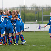 21120413 - IEPER, BELGIUM : Iceland's players gather to celebrate Sandra Jessen (16)  goal during the Second qualifying round of U17 Women Championship between England and Iceland on Friday April 13th, 2012 in Ieper, Belgium.