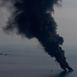 Smoke billows from controlled oil burns near the site of the BP Plc Deep Water Horizon oil spill site in the Gulf of Mexico off the coast of Louisiana, U.S., on Saturday, June 19, 2010. (Mandatory Credit: Derick E. Hingle)