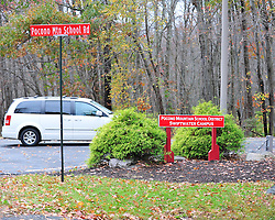 A minivan pulls into the Pocono Mountain School District campus Oct. 22, 2014, near Swiftwater, Pa. The campus was closed yesterday because of the manhunt for fugitive Eric Matthew Frein. (Chris Post | lehighvalleylive.com)
