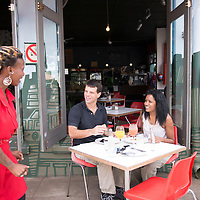 A couple enjoy al fresco dining at the Corner Cafe. The Corner Cafe is a popular eatery in the Glenwood neighborhood of Durban, South Africa.