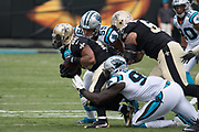 Luke Kuechly(59) and Mario Addison(97) tackle Mark Ingram(22) in the New Orleans Saints 34 to 13 victory over the Carolina Panthers.