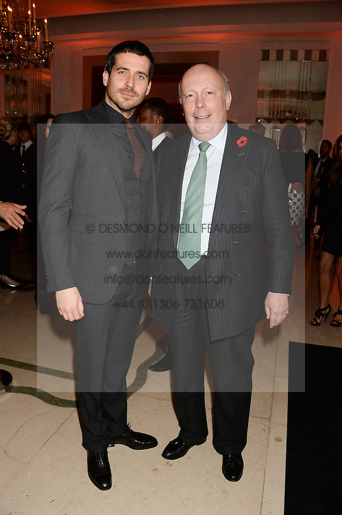 Left to right, actor ROB JAMES-COLLIER,  and JULIAN FELLOWES at the Harper's Bazaar Women of the Year 2013 in association with Estťe Lauder, Audemars Piguet and Selfridges & Co. held at Claridge's, Brook Street, London on 5th November 2013.