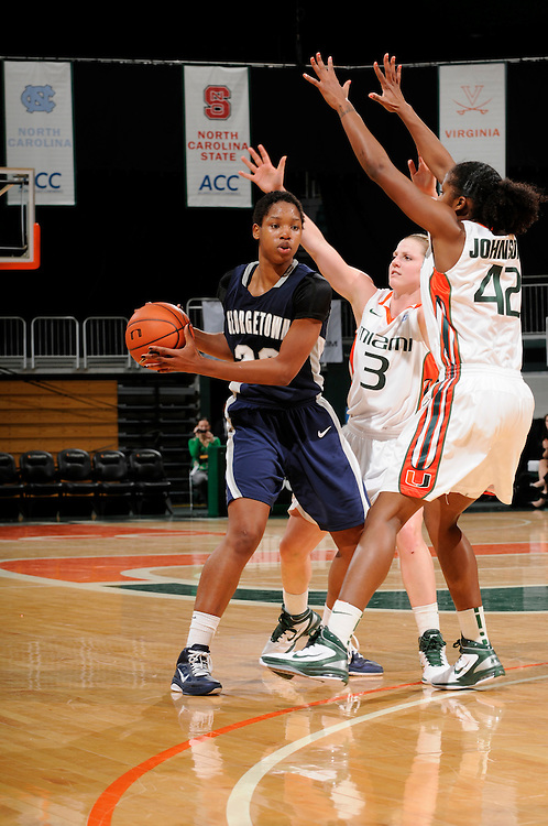 December 7, 2010: Monica McNutt of the Georgetown Hoyas looks to pass as Stefanie Yderstrom (3) and Shenise Johnson (42) of the Miami Hurricanes defend during the NCAA basketball game between Georgetown and Miami. The 'Canes defeated the Hoyas 81-72.