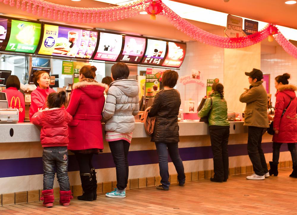CHONGQING, CHINA - JAN 25: customers in a McDonalds fastfood in Chonqing, Jan 25, 2011