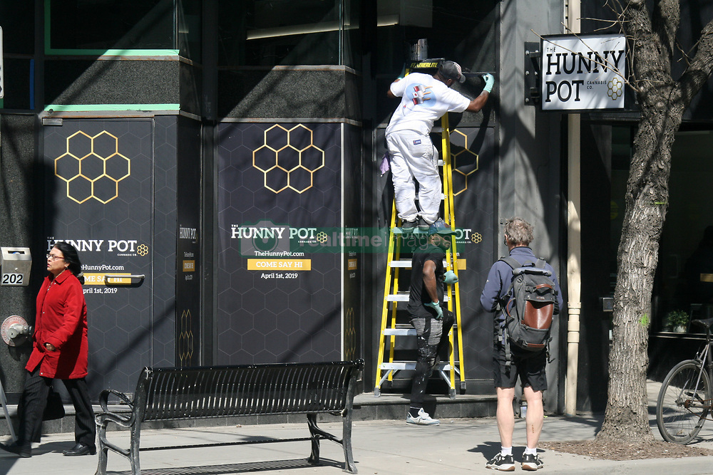 March 29, 2019 - Toronto, Ontario, Canada - Workers put the finishing touches on the exterior of the Hunny Pot legal cannabis retail store on Queen Street West in Toronto, Ontario, Canada, on March 29, 2019. With the April 1st provincially-imposed deadline for Ontario's 25 legal retail pot shops to open their doors to consumers, it seems that the majority of Toronto's legalized weed shops will not meet the deadline. So far the Hunny Pot is the only licensed cannabis retail store to confirm they will be opening by April 1. Cannabis stores that do not manage to open by April 1 run the risk of facing steep fines from the provincial government. (Credit Image: © Creative Touch Imaging Ltd/NurPhoto via ZUMA Press)