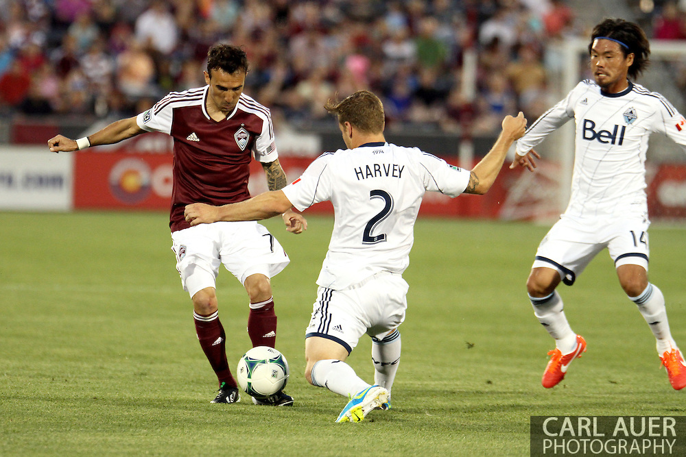 August 17th, 2013 - Colorado Rapids forward Vicente Sánchez (7) attempts to bring the ball past Vancouver Whitecaps FC defender Jordan Harvey (2) in the first half of the Major League Soccer match between the Vancouver Whitecaps FC and the Colorado Rapids at Dick's Sporting Goods Park in Commerce City, CO