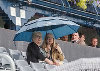 Tennis - 2019 Queen's Club Fever-Tree Championships - Day Two, Tuesday<br /> <br /> Heavy rain fails to deter determined tennis supporters as they remain seated awaiting play to start at Queens Club.<br />  <br /> COLORSPORT/DANIEL BEARHAM
