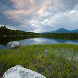 Clouds above Mount Katahdin and Katahdin Lake in Maine's Baxter State Park.