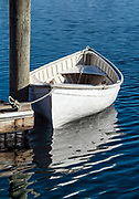 White rowboat tied to a dock, Vineyard Haven, Massachusetts, USA.