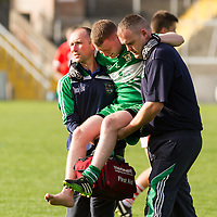 Wolfe Tone's Colm McCaul is carried off injured during the Intermediate Final against Corofin