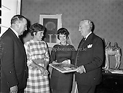 Mrs Pat Moss, the British racing driver's wife, is presented with sweaters. <br /> 06.04.1961