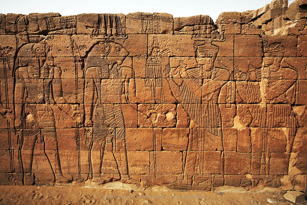 The Lion Temple, one of the Meroitic temples of Naqa, pictured on Sunday, April 1, 2007. The carved reliefs depict King Natakamani in the company of gods Horus and Apedemak. ..The ancient kingdom of Kush emerged around 2000 BC in the land of Nubia, what is today northern Sudan. At their height the Nubians ruled over ancient Egypt as the 25th Dynasty between 720 BC and 664 BC (known as the Black Pharaohs) and saw their borders reach to edges of Libya and Palestine. The Kushite kings saw themselves as guardians of Egyptian religion and tradition. They centered there kindgom on the Temple of Amun at Napata (modern day Jebel Barkal) and brought back the building of Pyramids in which to inter their kings - there are around 220 pyramids in Sudan, twice the number in Egypt. After Napata was sacked, by a resurgent Egypt, the capital was moved to Meroe where a more indigenous culture developed, Egyptian hieroglyphics made way for a cursive Meroitic script, yet to be deciphered. The Meroitic kingdom eventually fell into decline in the 3rd century AD with the arrival of Christianity.