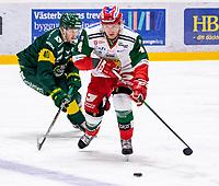 2019-12-02 | Umeå, Sweden:Björklöven (40) Sebastian Selin battles for the puck withMora (4) Viktor Amnér in  HockeyAllsvenskan during the game  between Björklöven and Mora at A3 Arena ( Photo by: Michael Lundström | Swe Press Photo )<br /> <br /> Keywords: Umeå, Hockey, HockeyAllsvenskan, A3 Arena, Björklöven, Mora, mlbm191202