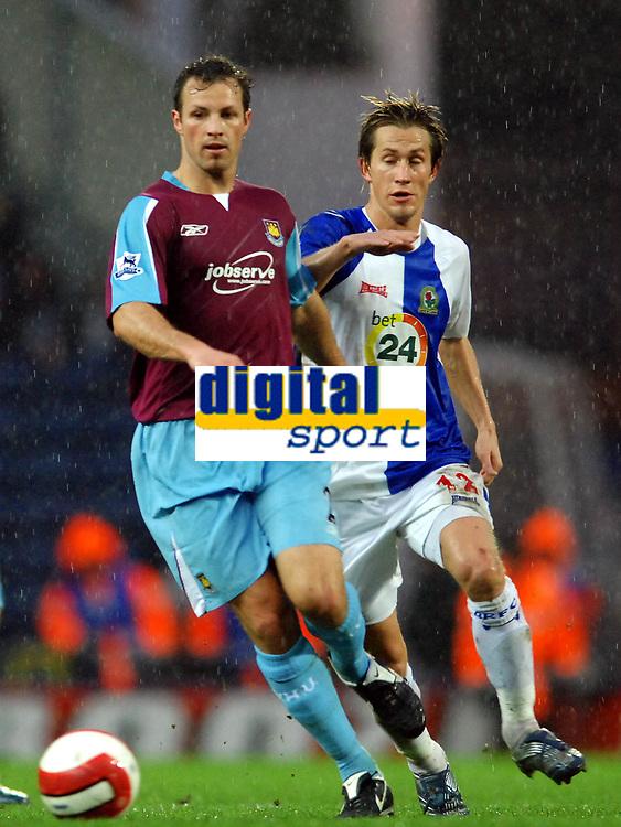 Photo: Paul Greenwood.<br />Blackburn Rovers v West Ham United. The Barclays Premiership. 17/03/2007.<br />West Ham's Lucas Neill (L) gets the better of Morten Gamst Pederson