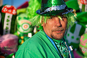 Sonny Hibbert sells sunglasses, hats, noisemakers, beads and other accessories from his cart at the Dallas St. Patrick's Parade along Greenville Avenue, Saturday, March 16, 2013. (Cooper Neill/The Dallas Morning News)