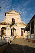 The Iglesia Parroquial de la Santisima Trinidad, Holy Trinity Church) in the Plaza Mayor of the UNESCO World Heritage Site of Trinidad.  <br /> Cuba