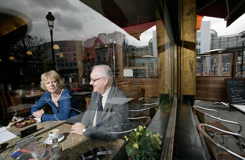 BRUSSELS - BELGIUM - 21 MARCH 2007 -- Karin RIIS-JØRGENSEN and Jens-Peter BONDE, both MEPs during a interview in a cafe. Here seen through the window where parliament buildings are mirrored.  PHOTO: ERIK LUNTANG