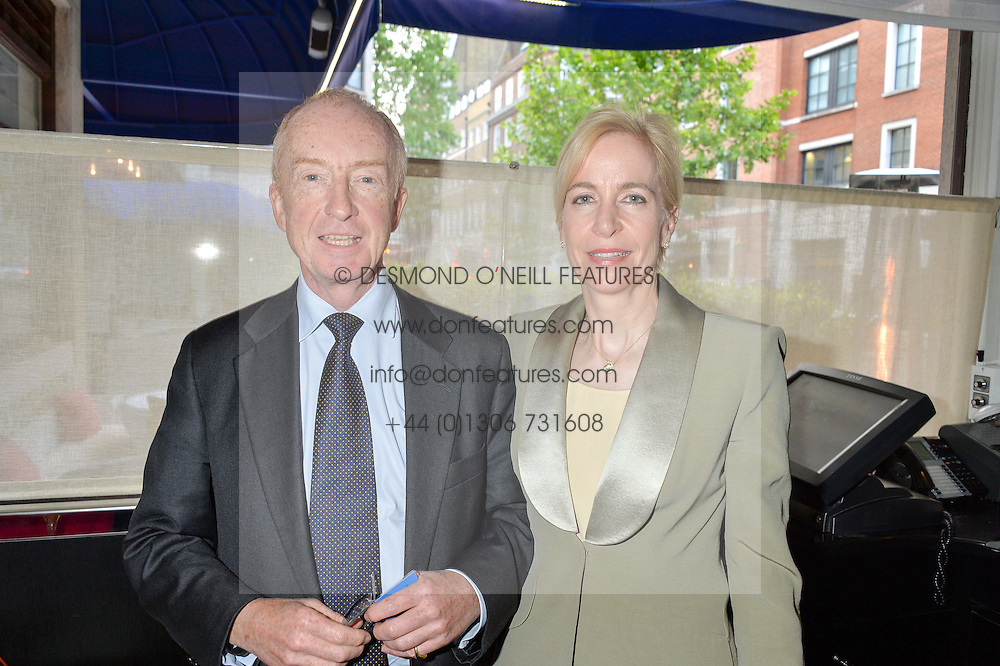 NICHOLAS WITCHELL and his wife MARIA at the Style for Soldiers dinner held at Le Caprice, 20 Arlington Street, London on 24th May 2016.