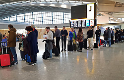 © Licensed to London News Pictures. 11/12/2017. London, UK. Passengers line up to attempt to check in at Heathrow's Terminal 5 after yesterday's snow continues to affect transport. British Airways had already cancelled 30 flights before 10am today. Photo credit: Peter Macdiarmid/LNP