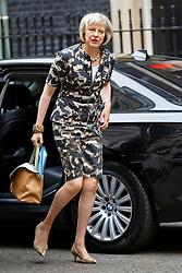 © Licensed to London News Pictures. 14/07/2015. London, UK. Home Secretary, Theresa May attending to a cabinet meeting in Downing Street on Tuesday, July 14, 2015. Photo credit: Tolga Akmen/LNP