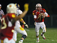 Marion's Trev Biery (33) waves to Trevor Hardman (7) to signal he is open during their second round playoff football game at Thomas Park Field in Marion on Monday, October 29, 2012.