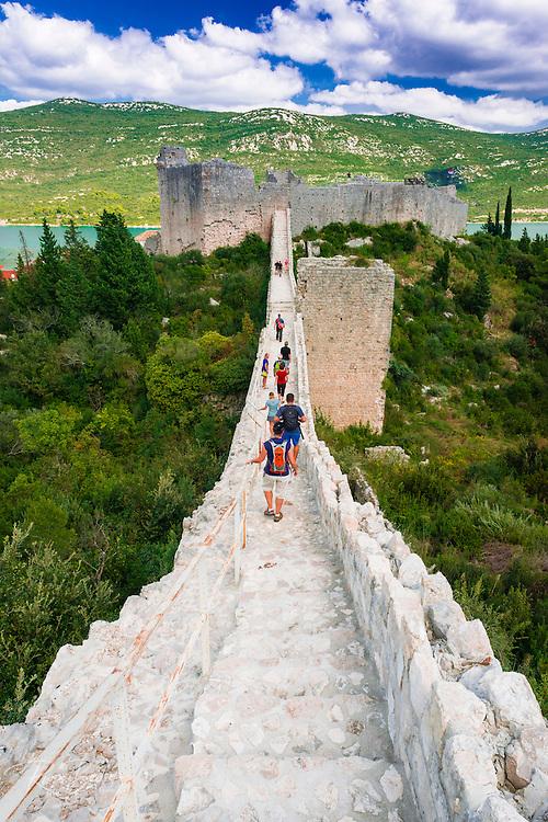 Tourists on the Great Wall above Mali Ston and the Adriatic, Ston, Dalmatian Coast, Croatia