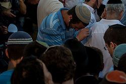 A Jewish man grieves for the three Israeli teens at a joint funeral at a cemetery in Modi'in near Jerusalem, on July 1, 2014. The three Israeli teens whose bodies were found Monday evening were brought to rest side by side on Tuesday at a joint funeral held in Modi'in near Jerusalem. Tens of thousands of people participated in the funeral, including Prime Minister Benjamin Netanyahu and President Shimon Peres, who eulogized the three, whose caskets were wrapped with Israeli flags. EXPA Pictures © 2014, PhotoCredit: EXPA/ Photoshot/ Li Rui<br /> <br /> *****ATTENTION - for AUT, SLO, CRO, SRB, BIH, MAZ only*****