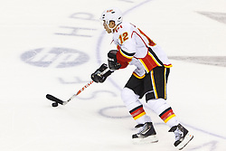 Jan 17, 2012; San Jose, CA, USA; Calgary Flames right wing Jarome Iginla (12) skates with the puck against the San Jose Sharks during shootouts at HP Pavilion. San Jose defeated Calgary 2-1 in shootouts. Mandatory Credit: Jason O. Watson-US PRESSWIRE