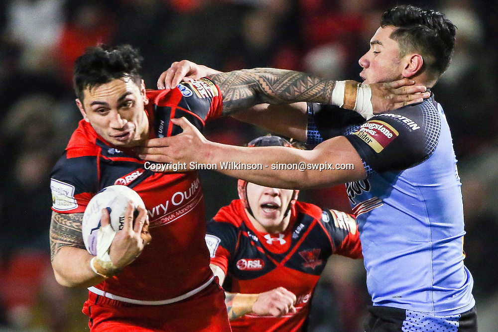Picture by Alex Whitehead/SWpix.com - 12/02/2015 - Rugby League - First Utility Super League - Salford Red Devils v St Helens - AJ Bell Stadium, Salford, England - Salford's Harrison Hansen is tackled by St Helens' Andre Savelio.