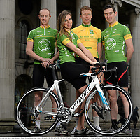29 January 2014; Model Aoife Cogan pictured with Irish riders Connor McConvey, Ronan McLaughlin and Roger Aiken at the launch of the 2014 An Post Rás. The race will begin on Sunday May 18th, in Dunboyne, Co. Meath, and finish on Sunday May 25th, in Skerries, Co. Dublin. An Post Rás 2014 Launch, GPO, O'Connell Street, Dublin. Picture credit: Brendan Moran / SPORTSFILE