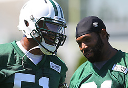 Jun 7, 2012; Florham Park, NJ, USA; New York Jets linebacker Aaron Maybin (51) and New York Jets cornerback Antonio Cromartie (31) during the New York Jets organized team activities at the Atlantic Health Training Center.