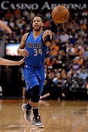 Apr 9, 2017; Phoenix, AZ, USA; Dallas Mavericks guard Devin Harris (34) makes a pass in the first half of the NBA game against the Phoenix Suns at Talking Stick Resort Arena. Mandatory Credit: Jennifer Stewart-USA TODAY Sports